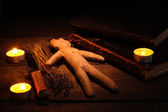 Voodoo doll boy on a wooden table in the candlelight — Foto Stock