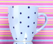 Сolor cup on color background — Stockfoto