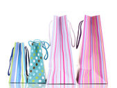 Colorful gift bags isolated on white — Stok fotoğraf
