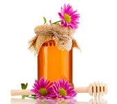 Dulce miel en tarro con drizzler aislado en blanco — Foto de Stock