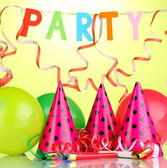 Party items on green background — Stock Photo