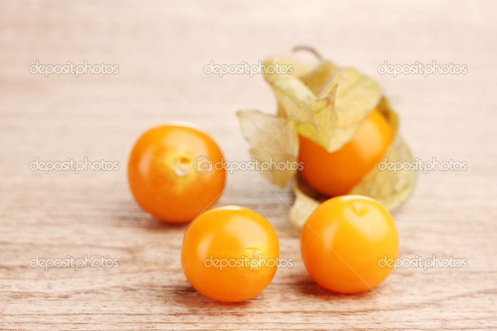 Physalis heap on wooden background — Stock Photo #10940995