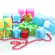 Stock Photo: Bright gifts with bows isolated on white
