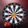 Darts with a sticker symbolizing health on colorful background — Lizenzfreies Foto