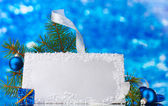 Blank postcard, Christmas balls and fir-tree on blue background — Stock Photo