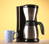 Coffee maker on yellow background — Stock Photo