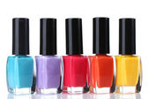 Group of bright nail polishes isolated on white — Stock Photo