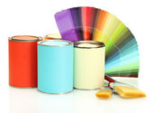 Tin cans with paint, brushes and bright palette of colors isolated on white — Stock Photo