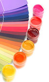 Colorful jars with gouache on a palette background close-up — Stock Photo