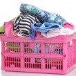 Clothes in pink plastic basket isolated on white — Stock Photo #10985695