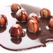 Delicious hazelnut and chocolate syrup isolated on white - Stock Photo