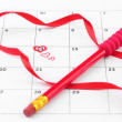 Calendar page with hearts, pencil and ribbon on St.Valentines Day — Stock Photo