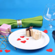 Table setting on blue background - Stock Photo