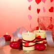 Candles for Valentine's Day on wooden table on red background — Stockfoto #10986355