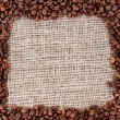 Frame of coffee beans on canvas background — Stock Photo