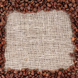 Frame of coffee beans on canvas background — 图库照片