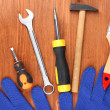 Set of tools and instruments on wooden background — Stock Photo #10987142