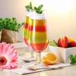 Fruit jelly in glasses and fruits on table in cafe — Stock Photo #10987215