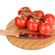 Fresh tomatoes and knife on wooden board isolated on white — Stock Photo #10987697