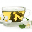 Cup of green tea with jasmine flowers isolated on white — Stock Photo #10988061