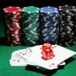 Cards, dices and chips for poker on green table - Stock Photo