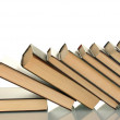 Foto Stock: Leaning stack of books on white background