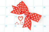 Calendar page with hearts and bow on St.Valentines Day — Stock Photo