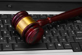 Wooden gavel on laptop computer close up — Stock Photo