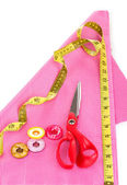 Scissors, buttons, measuring tape and pattern on fabric isolated on white — Stock Photo