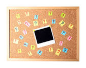 Photo with question marks cork board — Stock Photo