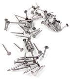 Metalowe gwoździe na białym tle — Zdjęcie stockowe