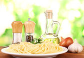Composition of the delicious spaghetti on green background — Stock Photo