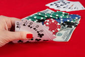 Woman's hand holding playing cards straight flush — Stockfoto