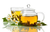 Green tea with jasmine in cup and teapot isolated on white — Stock Photo