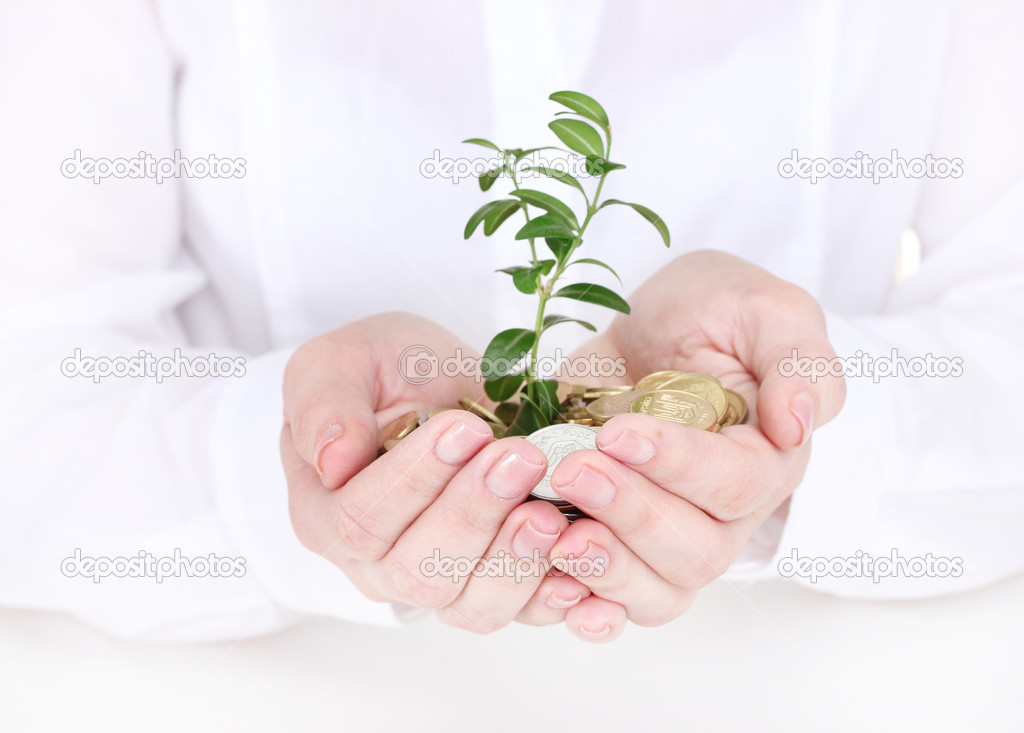 Woman hands with coins and plant — Stock Photo #10986989
