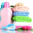Detergent with washing powder and towels isolated on white — Stock Photo #10992460