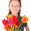 Portrait of beautiful little girl with tulips isolated on white — Stock Photo #10992663