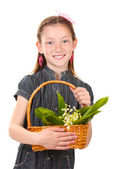 Portrait of beautiful little girl with lilies of the valley in basket isolated on white — Стоковое фото