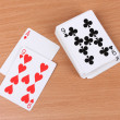 Cards on wooden background - Stock fotografie