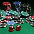 Dices and chips for poker on green table — Stock Photo