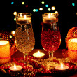 Amazing composition of candles and glasses on wooden table on bright background — Stock fotografie