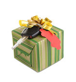 Car key with charm on gift box isolated on white — Stock Photo
