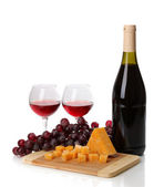 Bottle of great wine with wineglasses and cheese isolated on white — Stockfoto