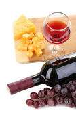Bottle of great wine with wineglass and cheese isolated on white — Stockfoto