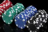 Casino chips isolated on black — Stock Photo
