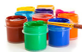 Jars with multicolored gouache on white background close-up — Stock Photo