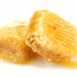 Golden honeycombs with honey isolated on white — Stock Photo