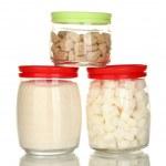 Постер, плакат: Jars with brown cane sugar lump white crystal sugar and white lump sugar isolated on white