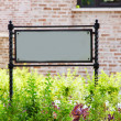 Signboard on lawn — Stockfoto