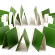 Stock Photo: Many green folders isolated on white